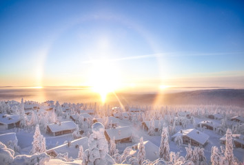 Snow covered cabins with sun halo, Lapland, Finland, Scandinavia, Europe Fototapete