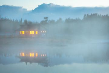 Cabin by lake in fog, Lapland, Finland, Scandinavia, Europe