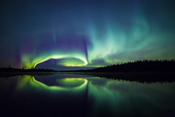 Northern lights reflected on lake, Lapland, Finland, Scandinavia, Europe