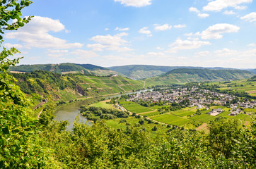 View to river Moselle and Marienburg Castle near village Puenderich - Mosel wine region in Germany