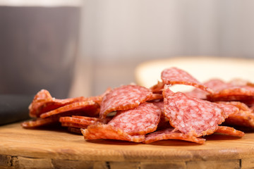 Sliced sausages on the wooden board with bread