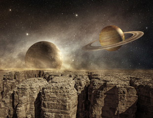 saturn and moon in the sky of a barren landscape