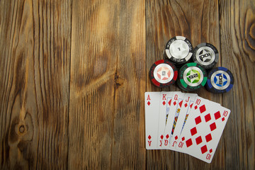 Combination of card game poker on the old wooden table