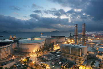 Power plant and oil tank at dusk