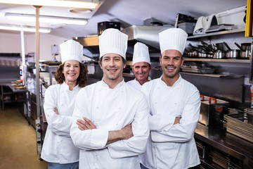 Group of happy chefs smiling at the camera