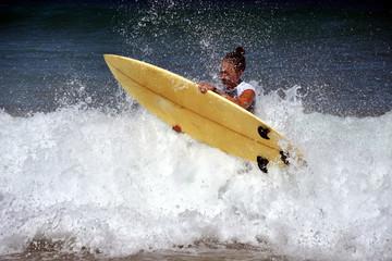 Beautiful surfer woman in bikini enjoying freedom on the beach.