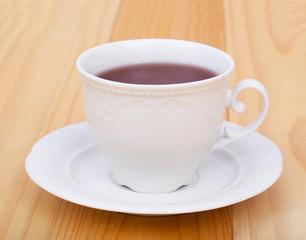 tea and macaroon on white