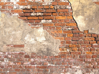 Old damaged brick wall and plaster