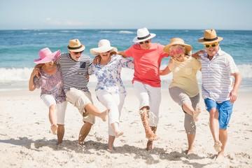 Senior friends dancing on the beach