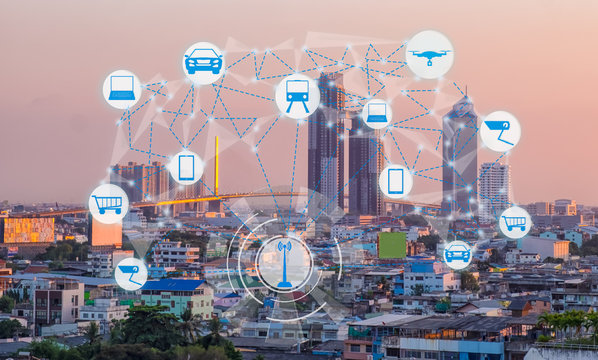 Internet of Things and Smart city concept. Smart things icons mesh on cityscape background.