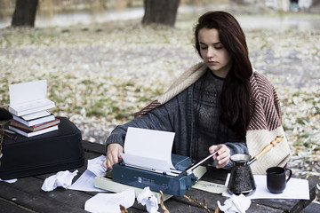 girl with a typewriter in the park