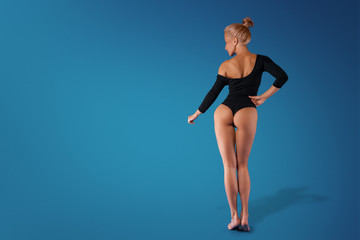 sexy sporty girl in bodysuit in the Studio