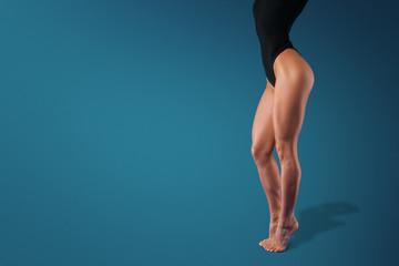 Sporty sexy slender female legs