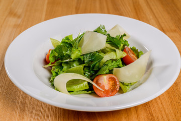Vegetable salad on a white plate