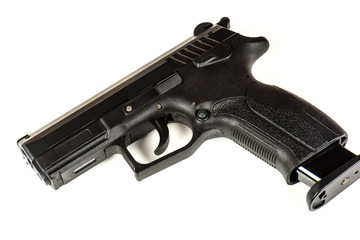 The black gun (pistol) on a white background close up. Isolate.