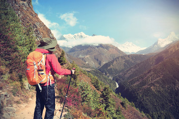 young woman backpacker enjoy the view on himalaya mountain trail