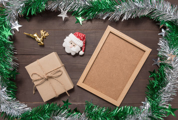 Decoration of Christmas day and picture frame are on the wooden