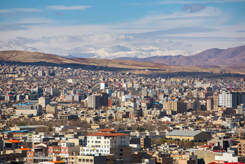Urmia city aerial view with mountains in the north-west of Iran
