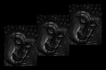 Traditional carved wooden Buddha in Thailand isolated on black background