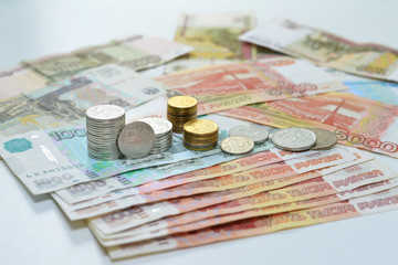 Russian roubles, coin stacks are on the bills