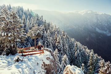 tourist man travel to snowy mountains background