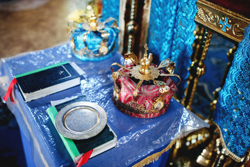 Bibles and crowns for the ceremony in the church