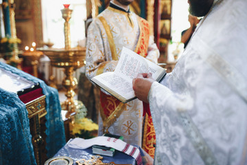 Priest reads a Bible on the ceremony in the church