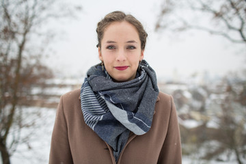 Young pretty woman in warm clothes