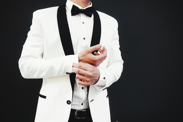 Stylish white jacket and a black bow-tie