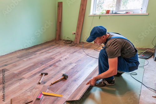Master Makes Laminated Floor Stock Photo And Royalty Free Images On