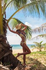 woman near palm on tropical holidays near sea