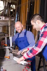 Two workmen in PVC shop