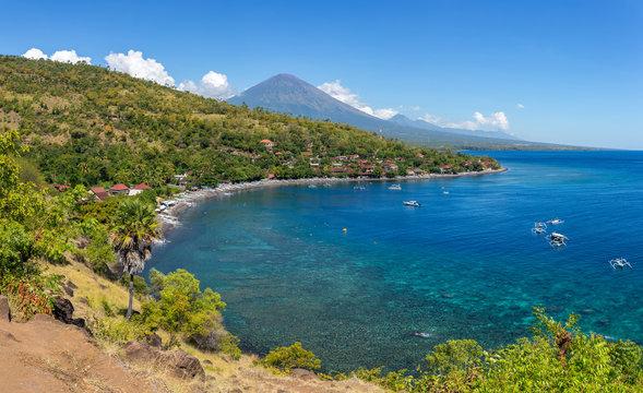 Jemeluk Beach and beautiful blue lagoon with Gunung Agung volcan