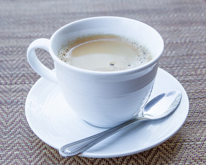 coffee in a white cup and saucer