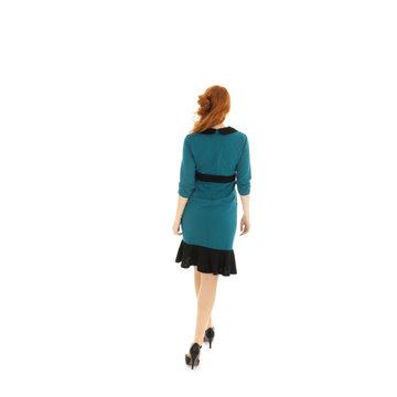 Pretty woman walking in studio