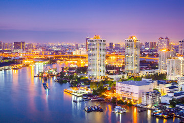 The City of Chaopraya river with light and reflection in twilight. Bangkok, Thailand