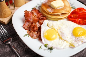 Eggs, bacon and pancakes for breakfast