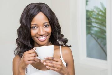 Young woman holding coffee mug