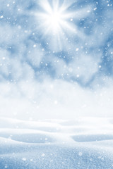 Winter background. Winter landscape with snowdrifts  and blue sky with clouds
