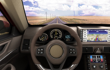 Front view dashboard of modern brand new car with road in the wi