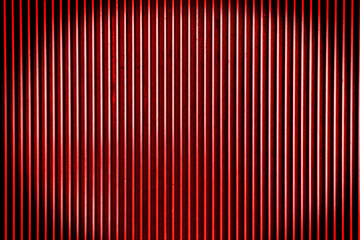 Red metal steel background with bright center spotlight and blac