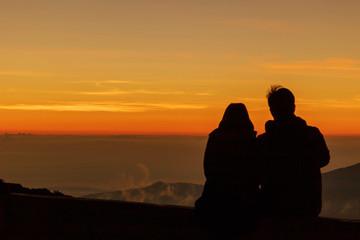 Silhouette couple watch sunrise