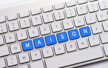MAISON writing on white keyboard