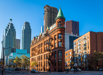 Wall Murals Toronto Gooderham or Flatiron Building in downtown Toronto with CN Tower on backgound - Toronto, Ontario, Canada