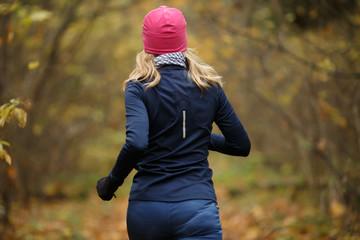 Blonde woman jogging in morning