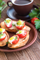 Baked eggs in tomato cups. Breakfast.