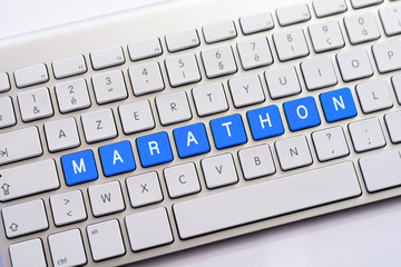 MARATHON writing on white keyboard