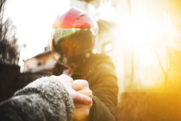 Photo of sexual biker girl in a red helmet and black jacket.