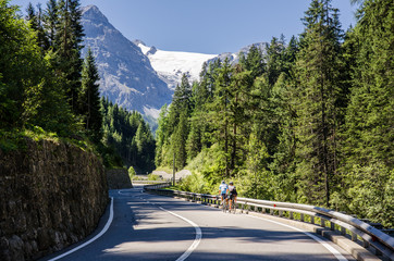 Turns of famous Passo Dello Stelvio Climb. Italian - Swiss border, Alpen. Original wallpaper with road, or theme of transport