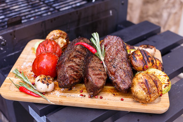 grill meat with grilled vegetables
